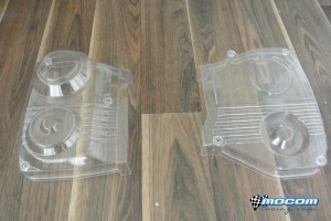 Here you can see both left and right hand clear timing belt covers for Subaru's EJ series engine's